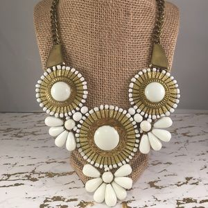 White and gold statement necklace.